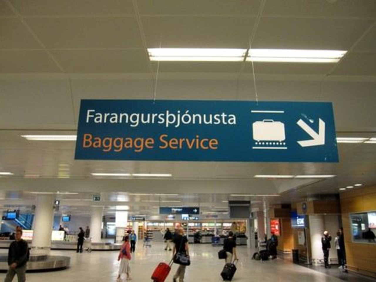 People walking around with suitcases in Keflavik airport in Iceland