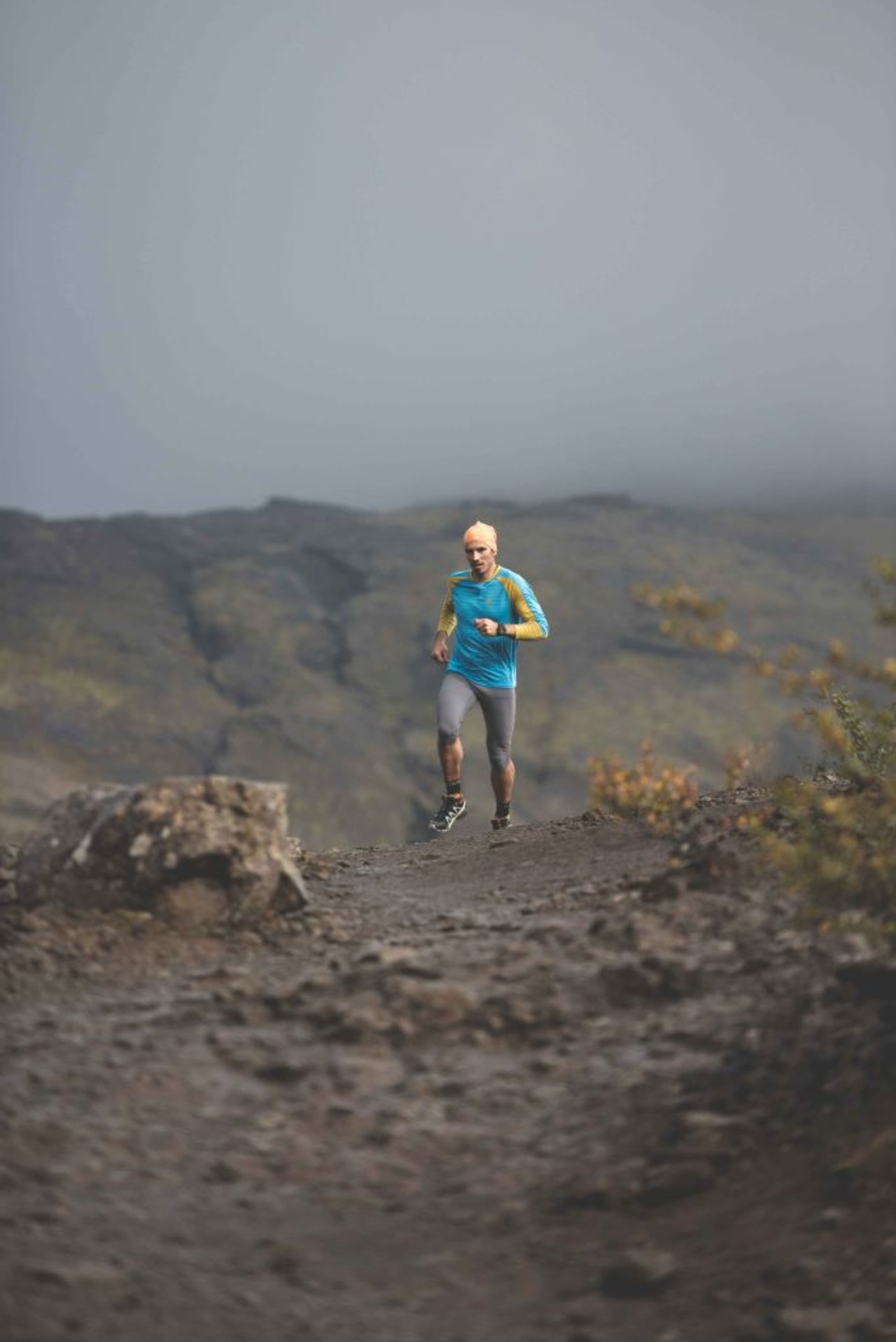 A man running in the highlands of Iceland