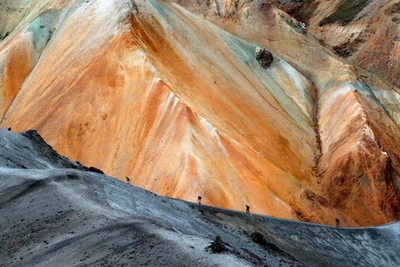 Hikers going up a hill in Landmannalaugar on a tour with Icelandic Mountain Guides