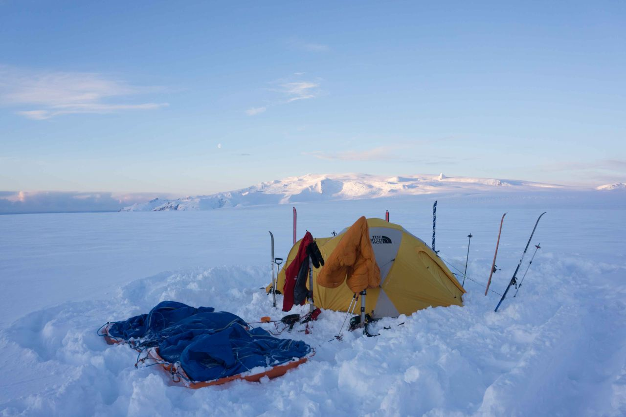 A tent camped on a glacier on a sunny day on a polar training course with Icelandic Mountain Guides