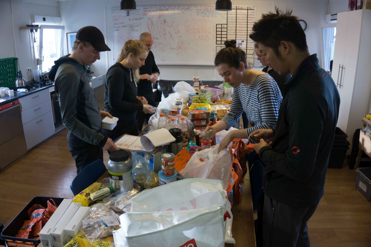 People preparing food on a polar training course with Icelandic Mountain Guides