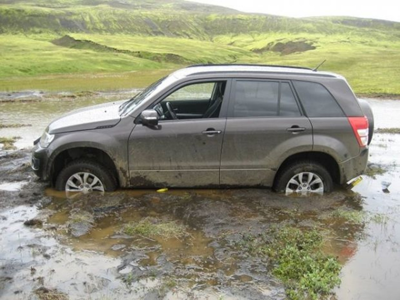 A car stuck in water after illegal off road driving