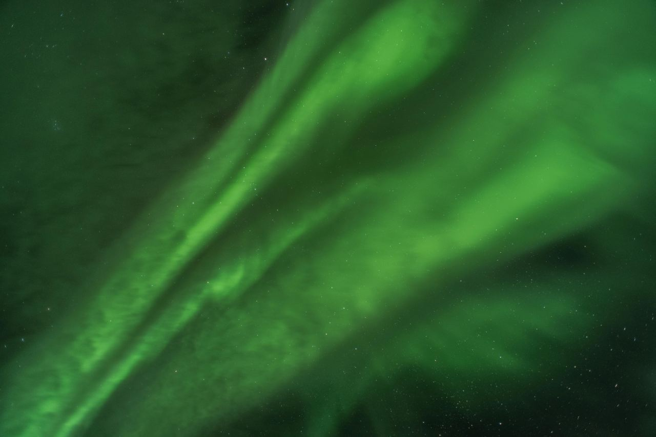 The bright greenNorthern Lights in Iceland dancing in the sky