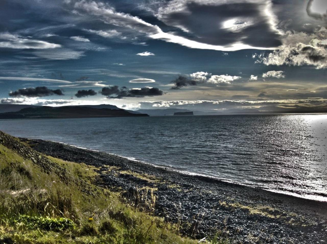 Beautiful black beach with mountains in the distance, Þórðarhöfði