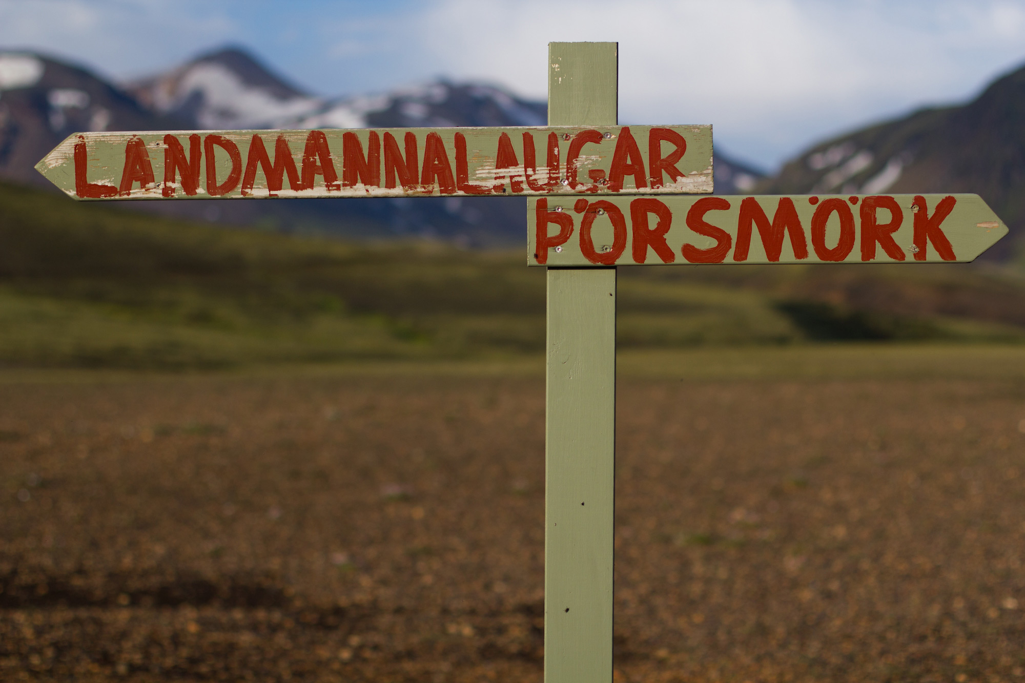 A sign in the Icelandic highlands that says Landmannalaugar to the left and Thorsmork to the right.