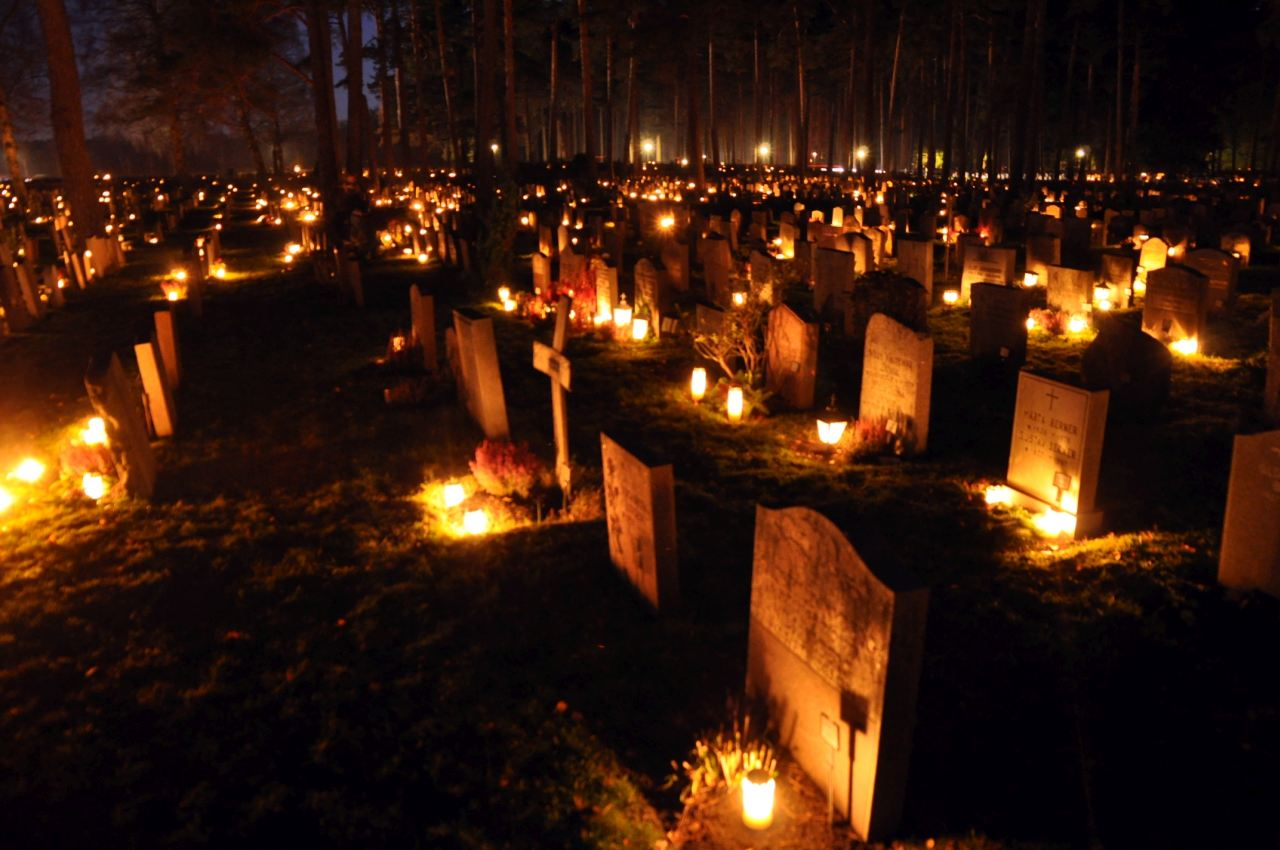 Cemetery during Christmas decorated with candles.