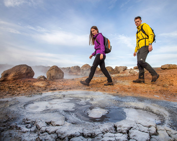 Testing: People walking past a geothermal mudpool