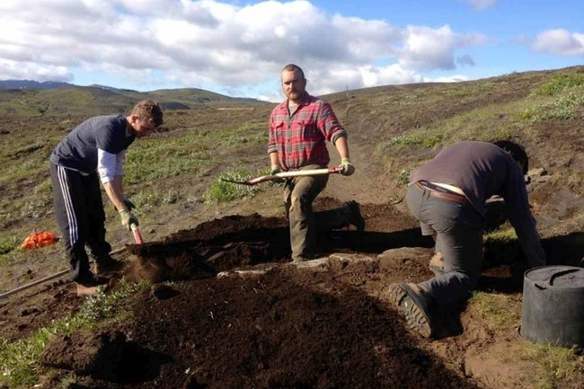 Three men working hard on digging in Iceland