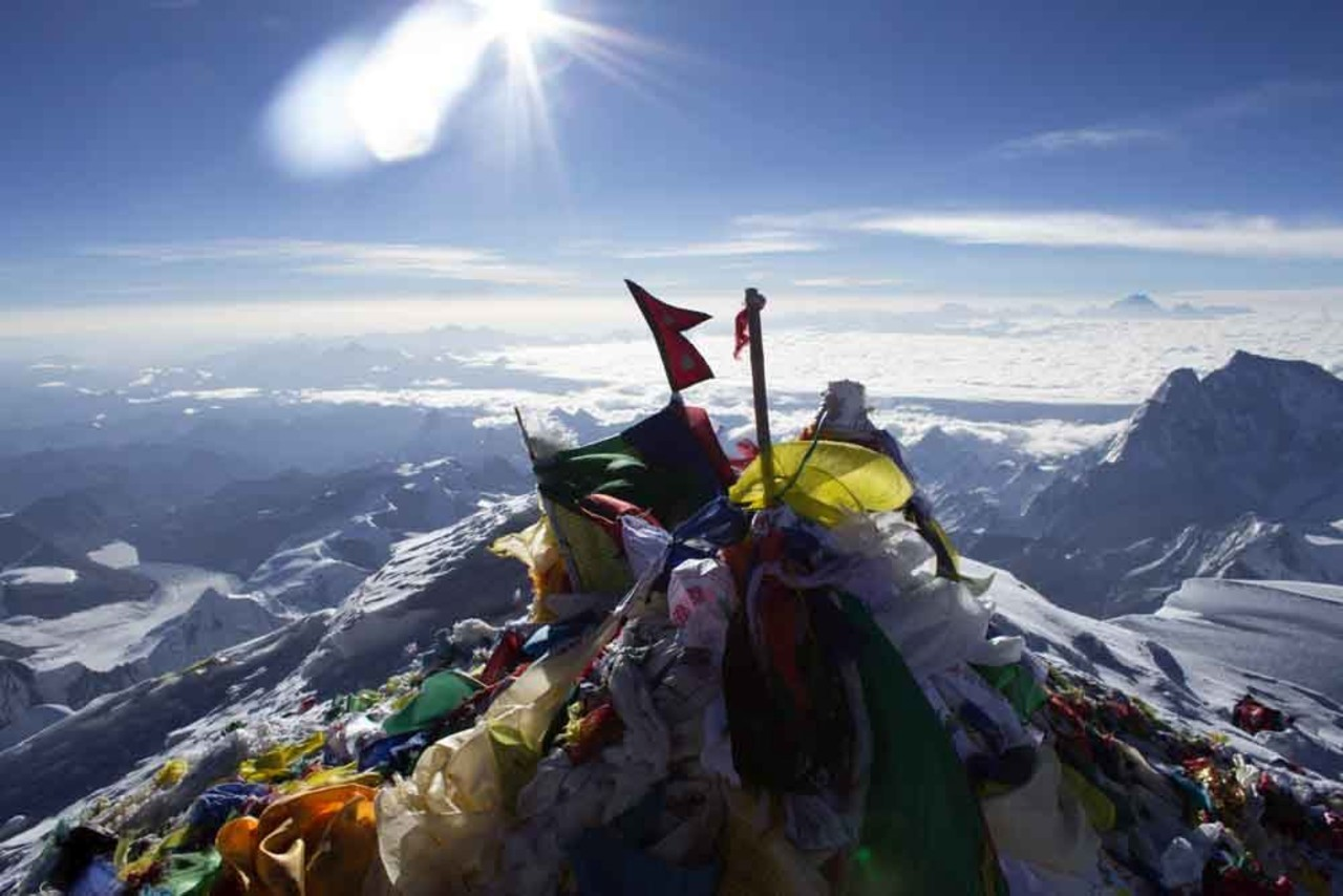The summit of Mt:Everest, covered in Nepalese prayer flags.