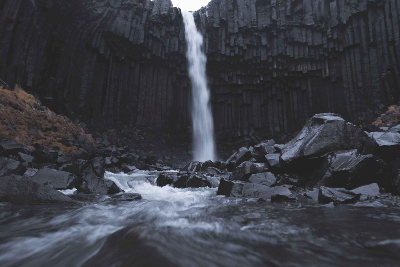 The waterfall Svartifoss in Skaftafell flows down the black rocks
