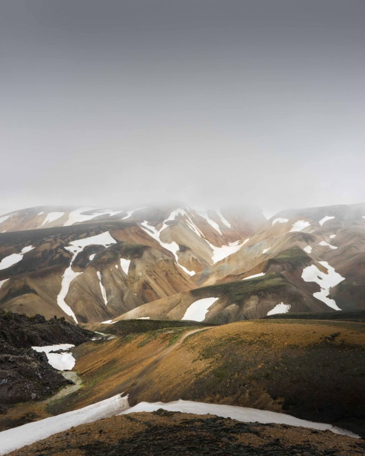 The colorful rhyolite mountains seen as you trek from Landmannalaugar to Thorsmork on the Laugavegur trail in the Icelandic highlands.